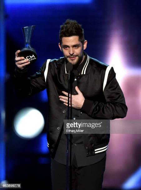 Recording artist Thomas Rhett accepts the Male Vocalist of the Year award onstage during the 52nd Academy of Country Music Awards at TMobile Arena on...