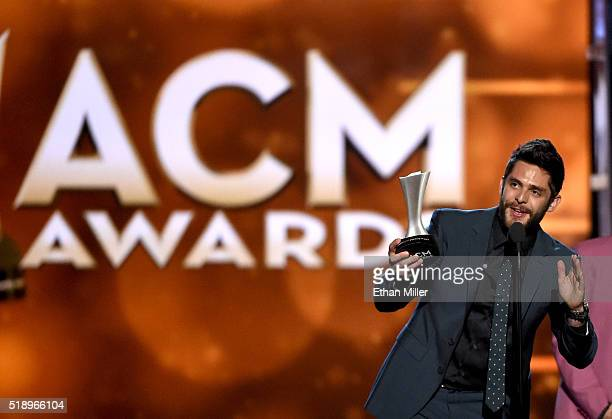 Recording artist Thomas Rhett accepts the Single Record of the Year award for 'Die a Happy Man' onstage during the 51st Academy of Country Music...