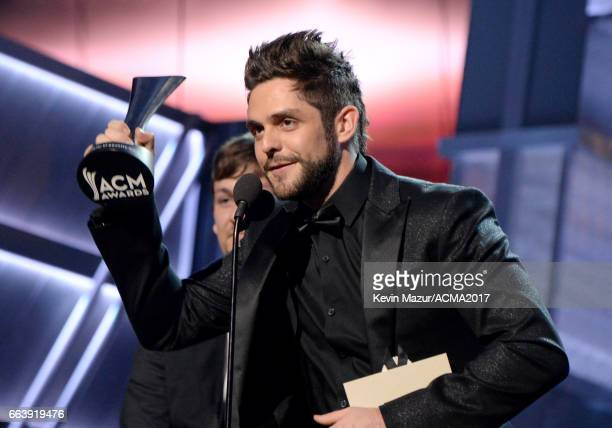 Recording artist Thomas Rhett accepts the Song of the Year award for 'Die a Happy Man' onstage during the 52nd Academy of Country Music Awards at...