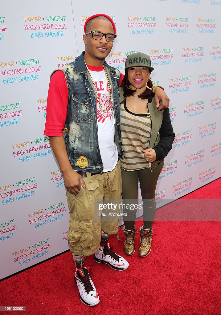 Recording Artist T.I. (L) and his wife Tameka Cottle (R) attend Tamar Braxton's carnival themed baby shower at the Hotel Bel-Air on May 5, 2013 in Los Angeles, California.