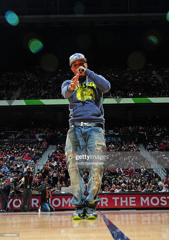 Recording artist <a gi-track='captionPersonalityLinkClicked' href=/galleries/search?phrase=T.I.&family=editorial&specificpeople=221599 ng-click='$event.stopPropagation()'>T.I.</a> performs at halftime of a game between the Chicago Bulls and Atlanta Hawks on December 22, 2012 at Philips Arena in Atlanta, Georgia.
