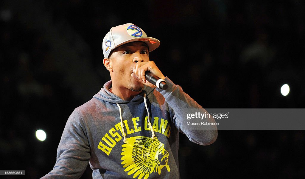 Recording Artist <a gi-track='captionPersonalityLinkClicked' href=/galleries/search?phrase=T.I.&family=editorial&specificpeople=221599 ng-click='$event.stopPropagation()'>T.I.</a> performs halftime at the Chicago Bulls vs Atlanta Hawks game at Phillips Arena on December 22, 2012 in Atlanta, Georgia.