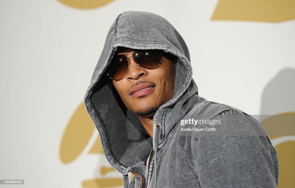 Recording artist <a gi-track='captionPersonalityLinkClicked' href=/galleries/search?phrase=T.I.&family=editorial&specificpeople=221599 ng-click='$event.stopPropagation()'>T.I.</a> poses in the press room at The GRAMMY Nominations Concert Live! Countdown To Music's Biggest Night at Nokia Theatre L.A. Live on December 6, 2013 in Los Angeles, California.