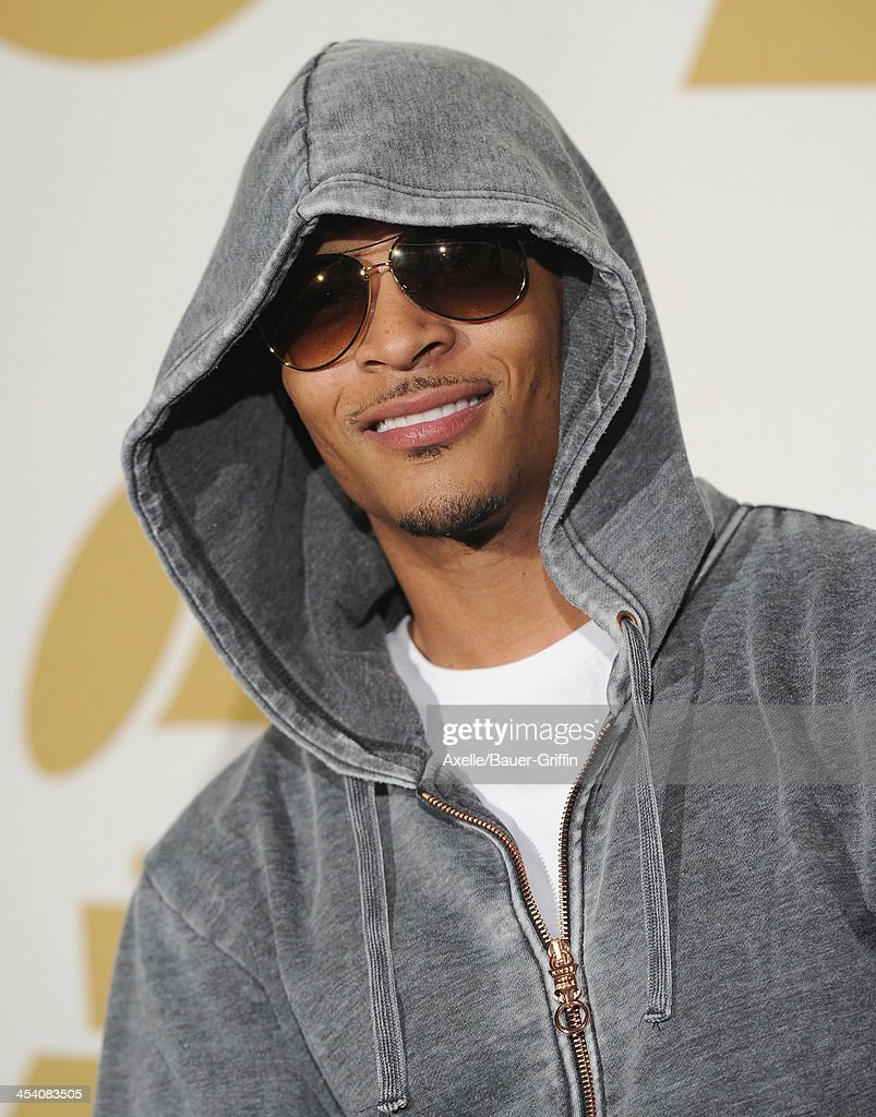 Recording artist T.I. poses in the press room at The GRAMMY Nominations Concert Live! Countdown To Music's Biggest Night at Nokia Theatre L.A. Live on December 6, 2013 in Los Angeles, California.
