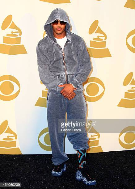 Recording artist TI poses in the press room during The GRAMMY Nominations Concert Live Countdown To Music's Biggest Night at Nokia Theatre LA Live on...