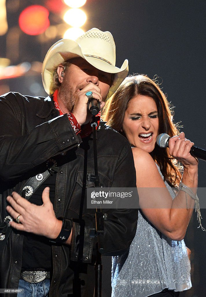 Recording artist <a gi-track='captionPersonalityLinkClicked' href=/galleries/search?phrase=Toby+Keith&family=editorial&specificpeople=204525 ng-click='$event.stopPropagation()'>Toby Keith</a> (L) and singer Mica Roberts perform onstage during the 49th Annual Academy of Country Music Awards at the MGM Grand Garden Arena on April 6, 2014 in Las Vegas, Nevada.