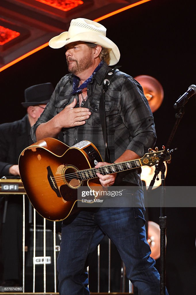 Singer <a gi-track='captionPersonalityLinkClicked' href=/galleries/search?phrase=Toby+Keith&family=editorial&specificpeople=204525 ng-click='$event.stopPropagation()'>Toby Keith</a> performs onstage during the 2016 American Country Countdown Awards at The Forum on May 1, 2016 in Inglewood, California.