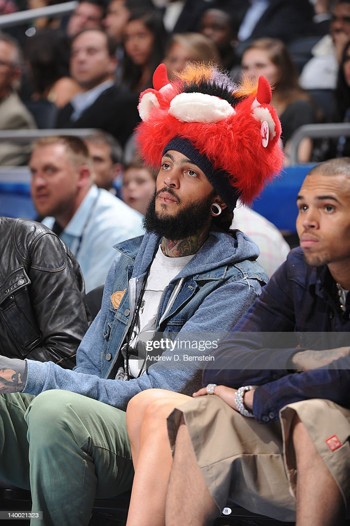 Recording artist <a gi-track='captionPersonalityLinkClicked' href=/galleries/search?phrase=Travie+McCoy&family=editorial&specificpeople=4979725 ng-click='$event.stopPropagation()'>Travie McCoy</a> sits courtside during the 2012 NBA All-Star Game presented by Kia Motors as part of 2012 All-Star Weekend at the Amway Center on February 26, 2012 in Orlando, Florida.