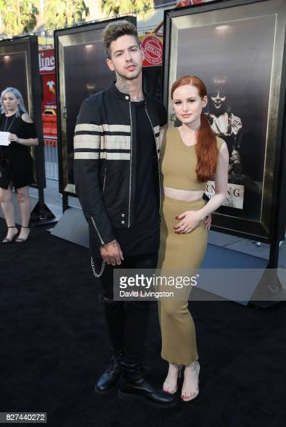 Recording artist Travis Mills and actress Madelaine Petsch attend the premiere of New Line Cinema's 'Annabelle Creation' at TCL Chinese Theatre on...