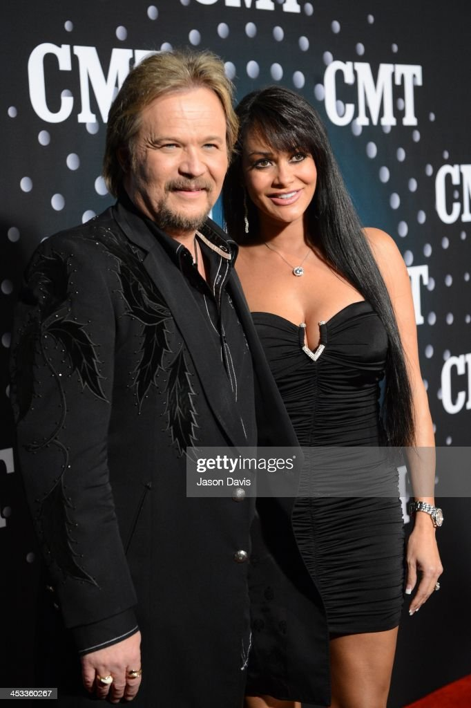 Recording Artist Travis Tritt and Theresa Nelson attend CMT Artists Of The Year 2013 on December 3 2013 in Nashville Tennessee