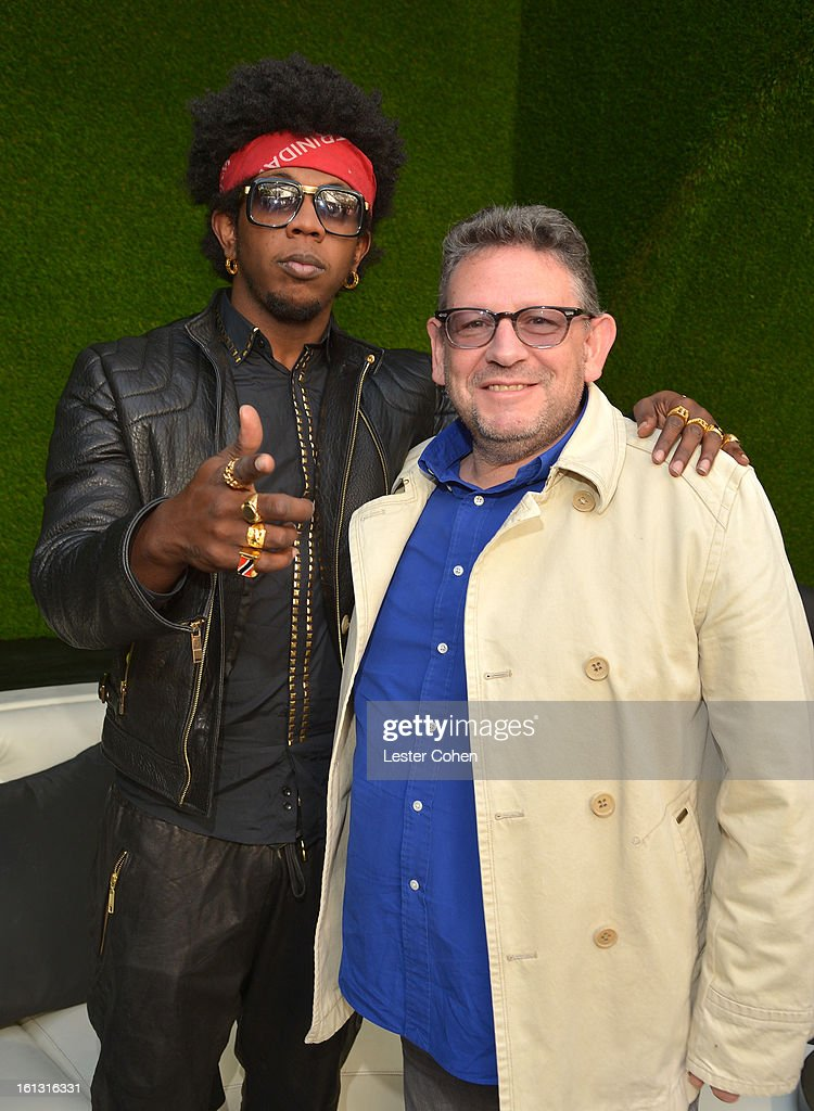 Recording artist Trinidad James (L) and Chairman/CEO of Universal Music International <a gi-track='captionPersonalityLinkClicked' href=/galleries/search?phrase=Lucian+Grainge&family=editorial&specificpeople=813742 ng-click='$event.stopPropagation()'>Lucian Grainge</a> attend Universal Music Group Showcase '13 Backstage at Lure on February 9, 2013 in Hollywood, California.
