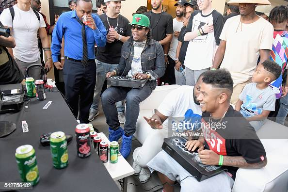 Recording artist Trinidad James and Lil Fizz attend Next Level Presented By AMP Energy A Hip Hop Gaming Tournament at Rostrum Records on June 23 2016...