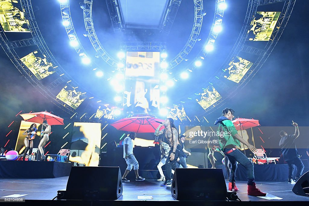 Recording artist Ty Dolla $ign (L) performs onstage with guest performer <a gi-track='captionPersonalityLinkClicked' href=/galleries/search?phrase=Slim+Jimmy&family=editorial&specificpeople=12935151 ng-click='$event.stopPropagation()'>Slim Jimmy</a> of Rae Sremmurd during the 2016 BET Experience at Staples Center on June 25, 2016 in Los Angeles, California.