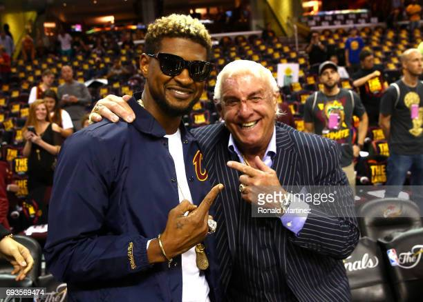 Recording artist Usher and former wrestler Ric Flair attend Game 3 of the 2017 NBA Finals between the Golden State Warriors and the Cleveland...