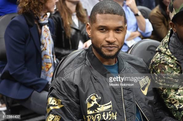 Recording artist Usher attends the Golden State Warriors v Atlanta Hawks Game at Philips Arena on February 22 2016 in Atlanta Georgia