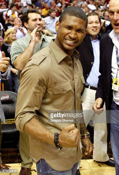 Recording artist Usher celebrates after the Cleveland Cavaliers defeat the Orlando Magic in Game Two of the Eastern Conference Finals during the 2009...