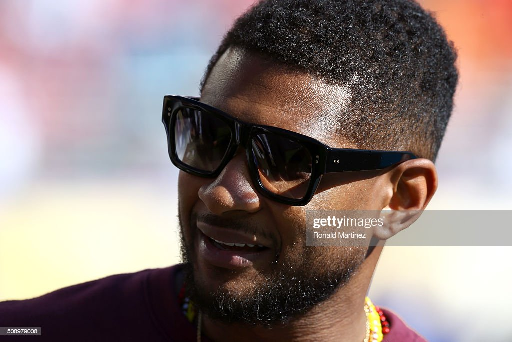 Recording artist <a gi-track='captionPersonalityLinkClicked' href=/galleries/search?phrase=Usher+-+Chanteur&family=editorial&specificpeople=201477 ng-click='$event.stopPropagation()'>Usher</a> looks on before Super Bowl 50 between the Denver Broncos and the Carolina Panthers at Levi's Stadium on February 7, 2016 in Santa Clara, California.