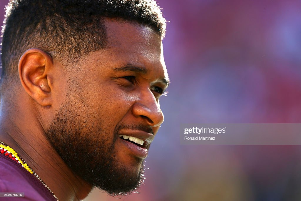 Recording artist Usher looks on before Super Bowl 50 between the Denver Broncos and the Carolina Panthers at Levi's Stadium on February 7, 2016 in Santa Clara, California.