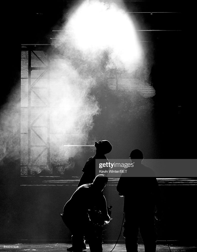 Recording artist <a gi-track='captionPersonalityLinkClicked' href=/galleries/search?phrase=Usher+-+Singer&family=editorial&specificpeople=201477 ng-click='$event.stopPropagation()'>Usher</a> (C) performs onstage during the 2016 BET Awards at the Microsoft Theater on June 26, 2016 in Los Angeles, California.