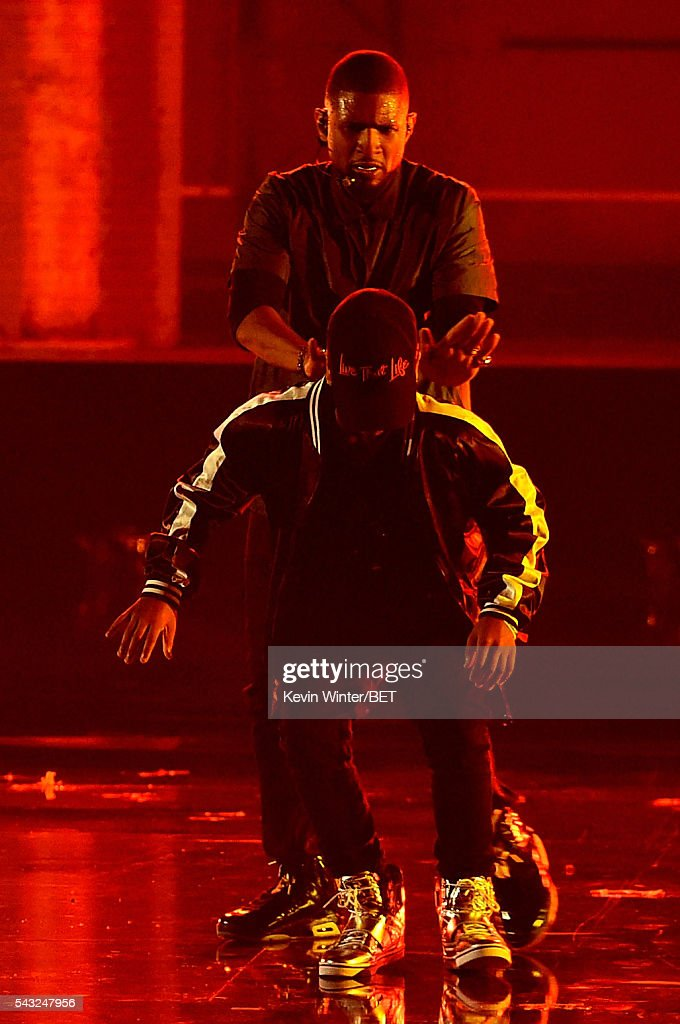 Recording artist <a gi-track='captionPersonalityLinkClicked' href=/galleries/search?phrase=Usher+-+Singer&family=editorial&specificpeople=201477 ng-click='$event.stopPropagation()'>Usher</a> (back) performs onstage during the 2016 BET Awards at the Microsoft Theater on June 26, 2016 in Los Angeles, California.