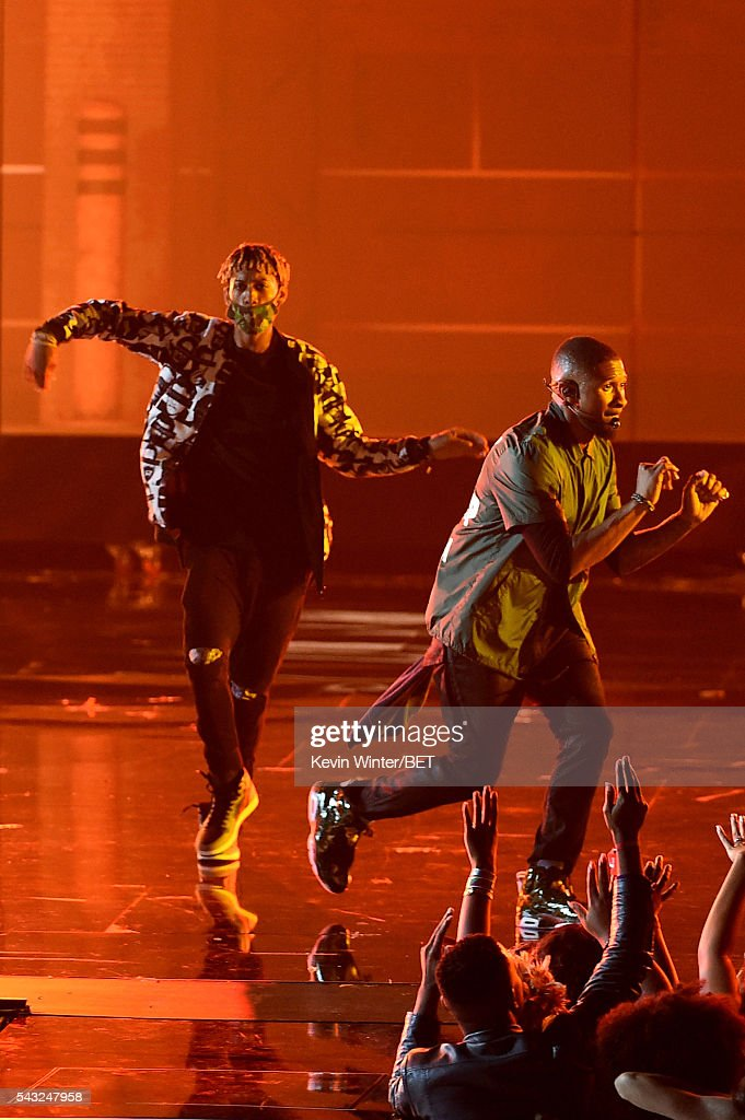 Recording artist <a gi-track='captionPersonalityLinkClicked' href=/galleries/search?phrase=Usher+-+Singer&family=editorial&specificpeople=201477 ng-click='$event.stopPropagation()'>Usher</a> (R) performs onstage during the 2016 BET Awards at the Microsoft Theater on June 26, 2016 in Los Angeles, California.