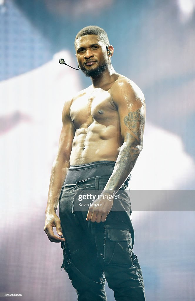 Recording artist Usher performs onstage during 'The UR Experience' tour at Staples Center on November 21 2014 in Los Angeles California