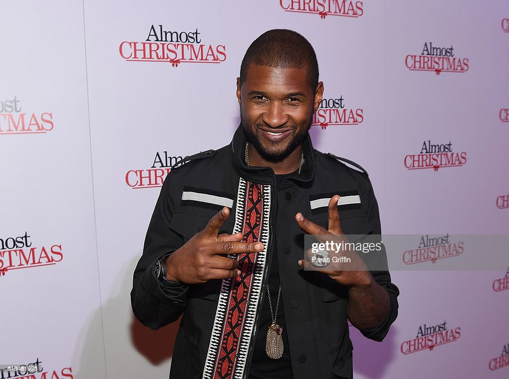Recording artist Usher Raymond attends 'Almost Christmas' Atlanta screening at Regal Cinemas Atlantic Station Stadium 16 on October 26, 2016 in Atlanta, Georgia.