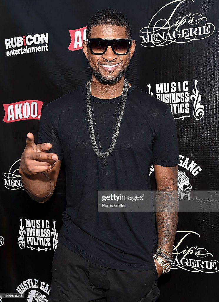Recording artist Usher Raymond attends 'Festa De Rei Feast of Kings' at Little Italia on September 21 2014 in Atlanta Georgia