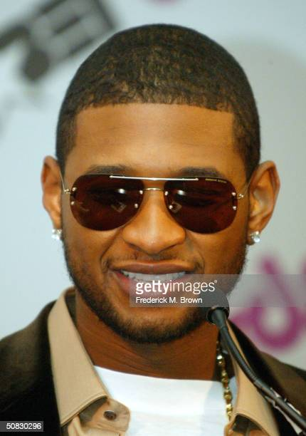 Recording artist Usher speaks during the Fourth Annual BET Awards nominations press conference on May 12 2004 at the Hollywood Renaissance Hotel in...