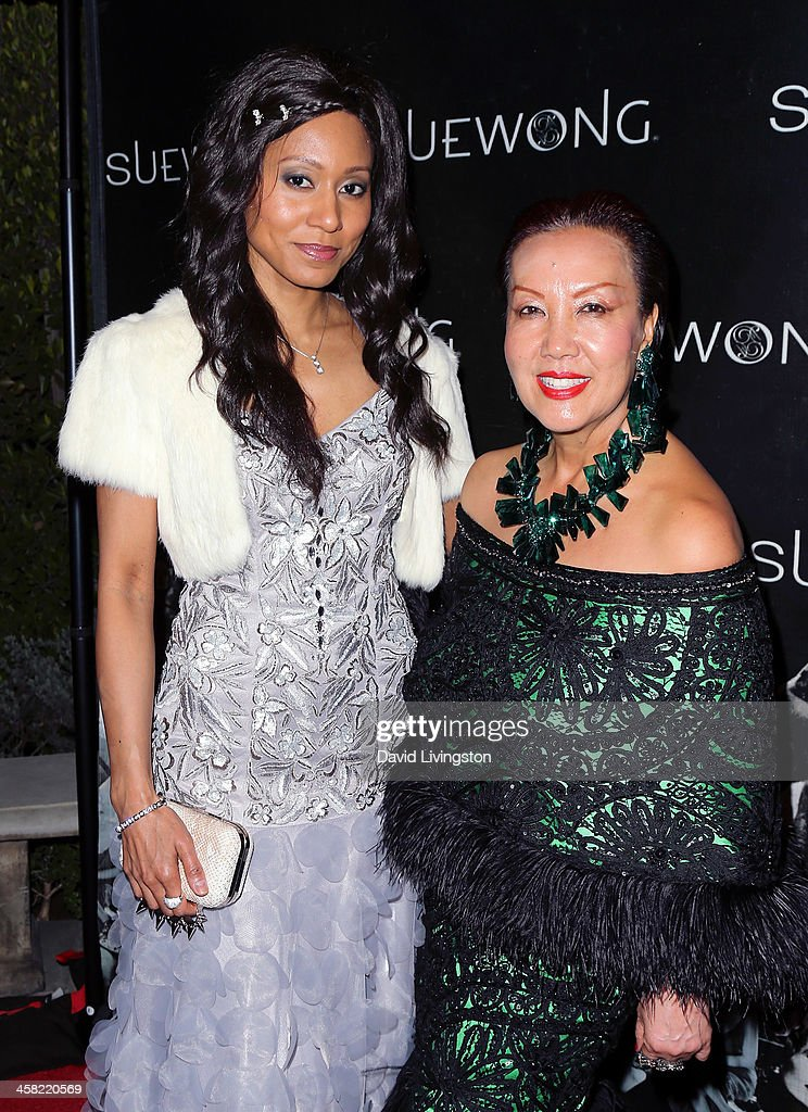 Recording artist Vaja Alani (L) and designer Sue Wong attend Sue Wong's holiday party at her home on December 20, 2013 in Los Angeles, California.