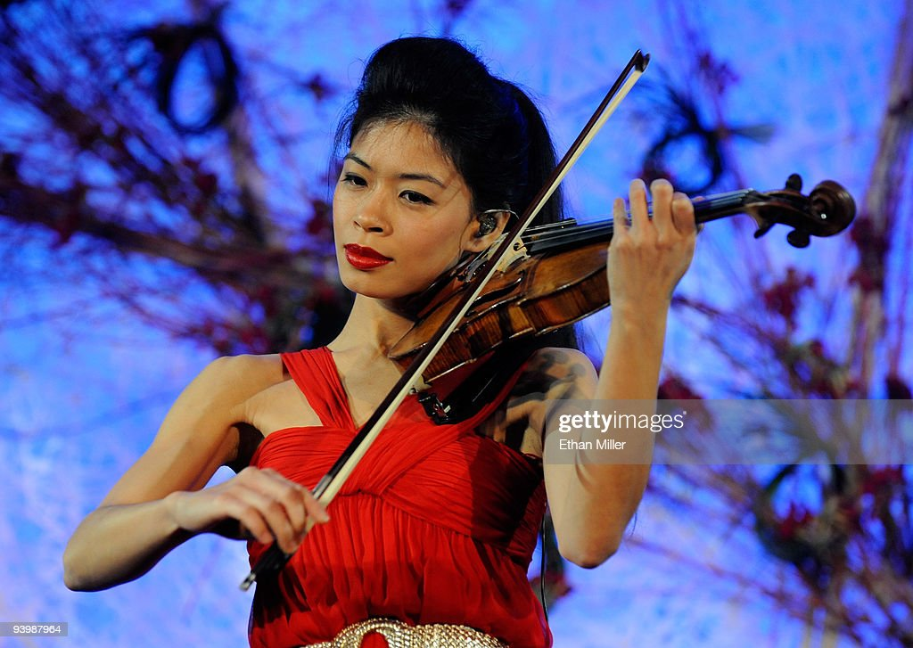 Recording artist Vanessa-Mae performs during the opening night gala for Mandarin Oriental, Las Vegas at CityCenter December 4, 2009 in Las Vegas, Nevada. The 47-story nongaming luxury hotel and condominium tower is the third part of the 67-acre, USD 8.5 billion mixed-use urban development center to open. The joint project between MGM Mirage and Dubai World is said to be the biggest privately financed construction project in United States history and one of the world's largest green projects being built with the Leadership in Energy & Environmental Design (LEED) Gold certified Green Building Rating System.