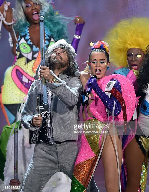 Recording artist Wayne Coyne of The Flaming Lips and host Miley Cyrus styled by Simone Harouche perform onstage during the 2015 MTV Video Music...