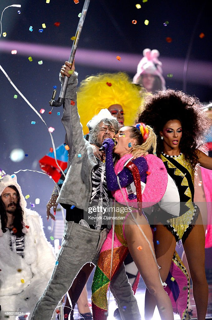 Recording artist Wayne Coyne of The Flaming Lips (L) and host Miley Cyrus, styled by Simone Harouche, perform onstage during the 2015 MTV Video Music Awards at Microsoft Theater on August 30, 2015 in Los Angeles, California.