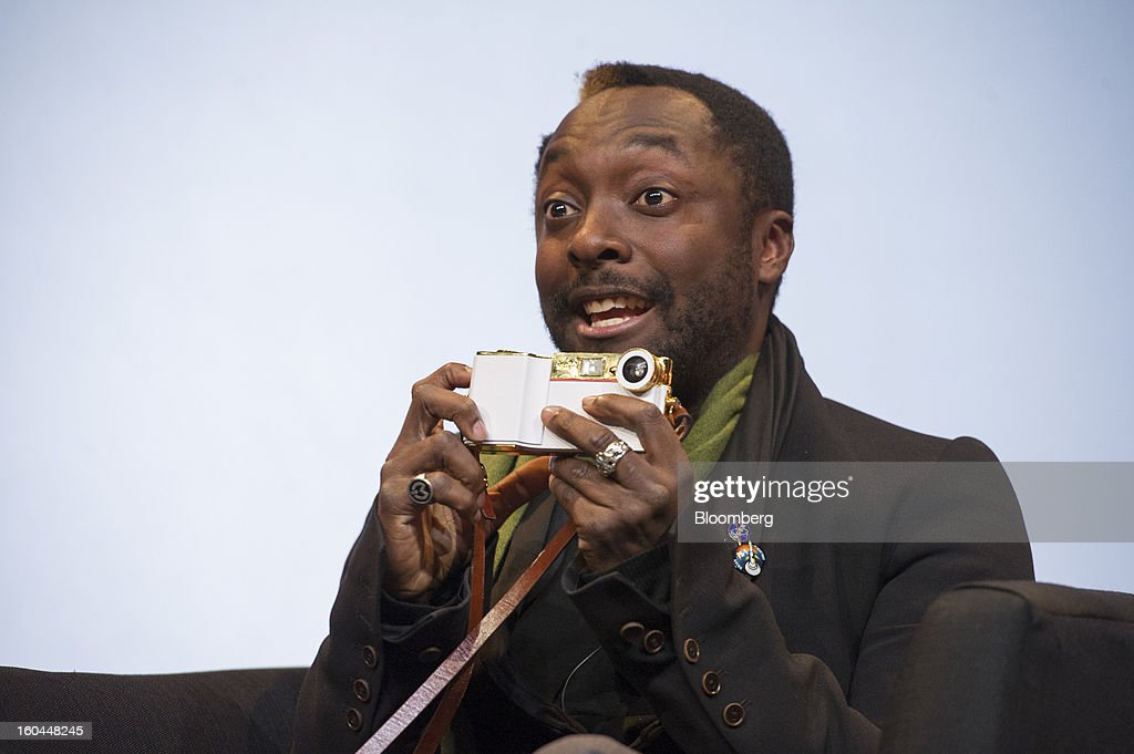 Recording artist Will.i.am holds his I.am+ foto.sosho case for the Apple Inc. iPhone as he speaks at the Macworld/iWorld conference at the Moscone Center West in San Francisco, California, U.S., on Thursday, Jan. 31, 2013. This year's conference, titled 'The Ultimate iFANEvent,' brings together attendees to celebrate Apple Inc. technology and learn more about products and services for Apple users. Photographer: David Paul Morris/Bloomberg via Getty Images