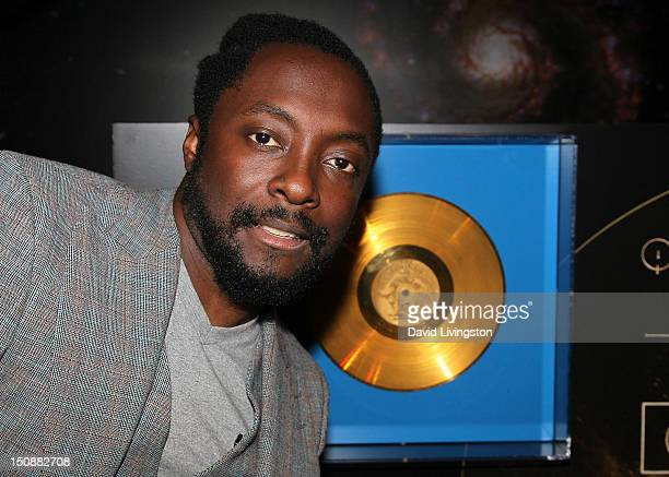 Recording artist william poses with a facsimile of the Voyager Golden Record at NASA joining william and Discovery Education for the premiere of...