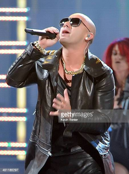 Recording artist Wisin performs onstage during The 14th Annual Latin GRAMMY Awards at the Mandalay Bay Events Center on November 21 2013 in Las Vegas...