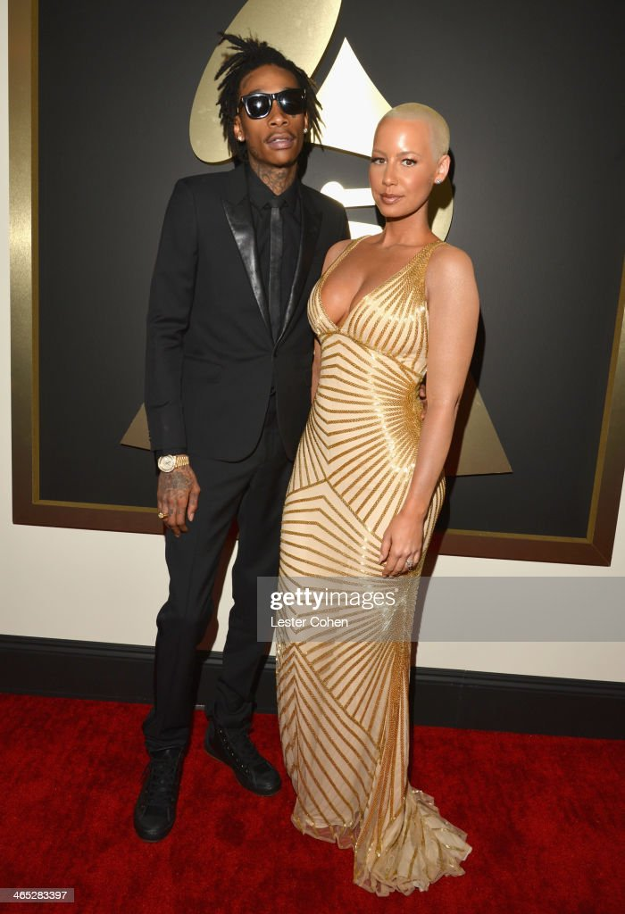Recording artist Wiz Khalifa (L) featured wearing Converse in support of the GRAMMY Foundation's GRAMMY Camp and model Amber Rose attend the 56th GRAMMY Awards at Staples Center on January 26, 2014 in Los Angeles, California.