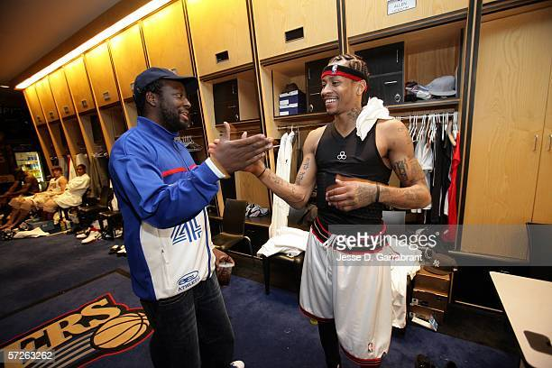 Recording artist Wyclef Jean and Allen Iverson of the Philadelphia 76ers in the locker room after the game against the Chicago Bulls on April 5 2006...