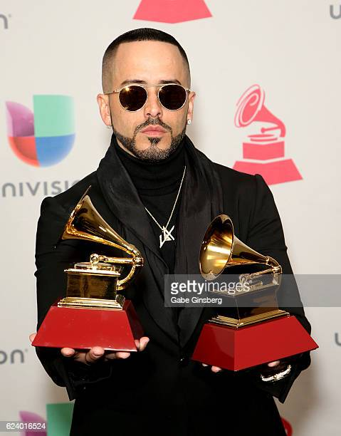 Recording artist Yandel poses with Best Urban Fusion/Performance and Best Urban Song awards in the press room during The 17th Annual Latin Grammy...