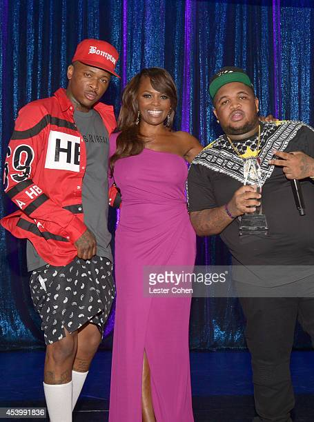 Recording artist YG BMI Vice President of Writer/Publisher Relations Catherine Brewton and DJ Mustard attend the 2014 BMI RB/HipHop Awards at the...