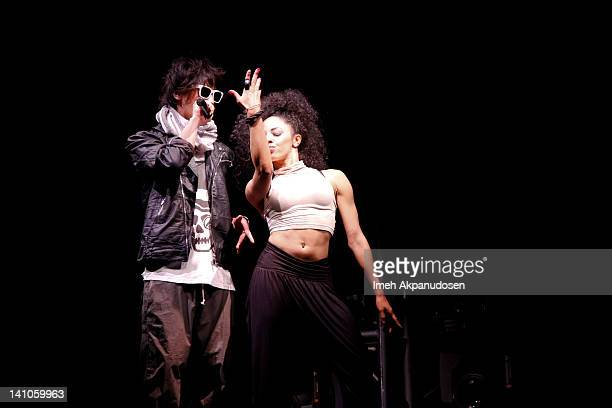 Recording artist/actor Jin Akanishi performs with a dancer onstage at Club Nokia on March 9 2012 in Los Angeles California