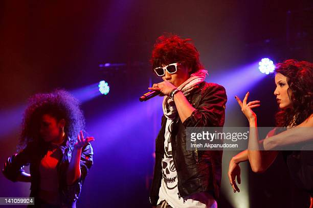 Recording artist/actor Jin Akanishi performs with dancers onstage at Club Nokia on March 9 2012 in Los Angeles California