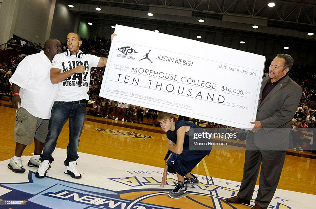 Recording Artist/Actor Ludacris, recording artist Justin Bieber and Morehouse College President, Dr. Robert Michael Franklin attend the 2011 LudaDay Weekend on September 4, 2011 in Atlanta, Georgia.