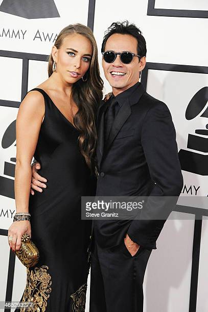 Recording artist/actor Marc Anthony and Chloe Green attend the 56th GRAMMY Awards at Staples Center on January 26 2014 in Los Angeles California