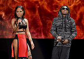 Recording artist/actress Christina Milian and recording artist Lil Wayne perform onstage at the 2014 American Music Awards at Nokia Theatre LA Live...
