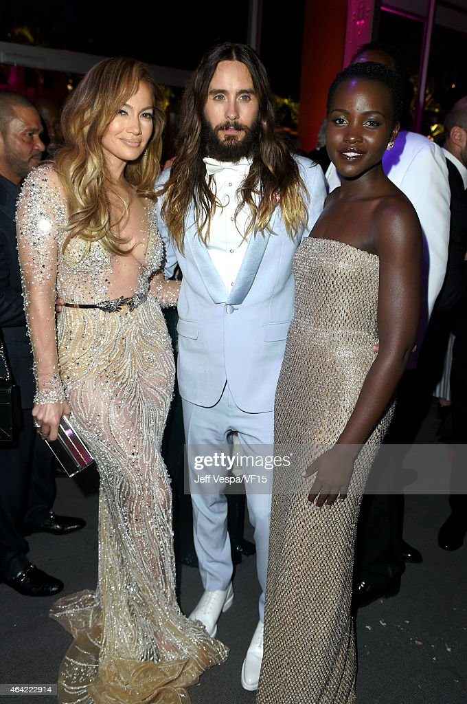 Recording artist/actress Jennifer Lopez actor Jared Leto and actress Lupita Nyong'o attend the 2015 Vanity Fair Oscar Party hosted by Graydon Carter...