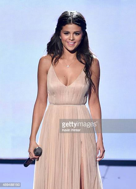 Recording artist/actress Selena Gomez performs onstage at the 2014 American Music Awards at Nokia Theatre LA Live on November 23 2014 in Los Angeles...