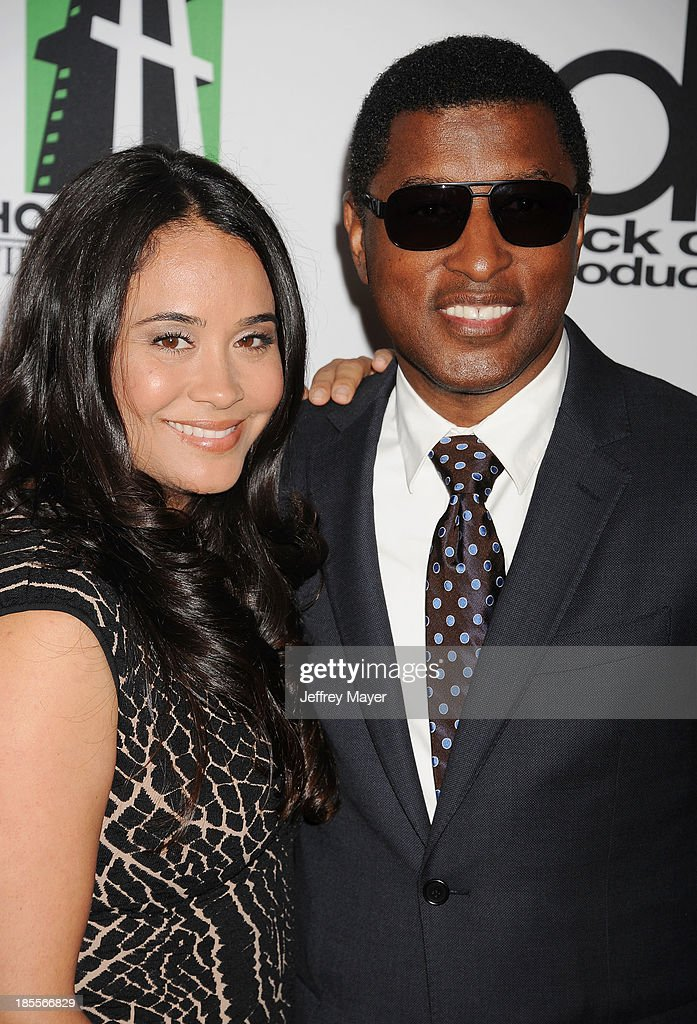 Recording artist/producer Kenneth 'Babyface' Edmonds (R) and Nicole Pantenburg arrive at the 17th Annual Hollywood Film Awards at The Beverly Hilton Hotel on October 21, 2013 in Beverly Hills, California.