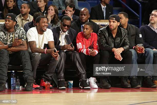 Recording artists 2 Chainz Meek Mill Sean Combs and Drake sit courtside during the 2014 NBA AllStar Game at Smoothie King Center on February 16 2014...