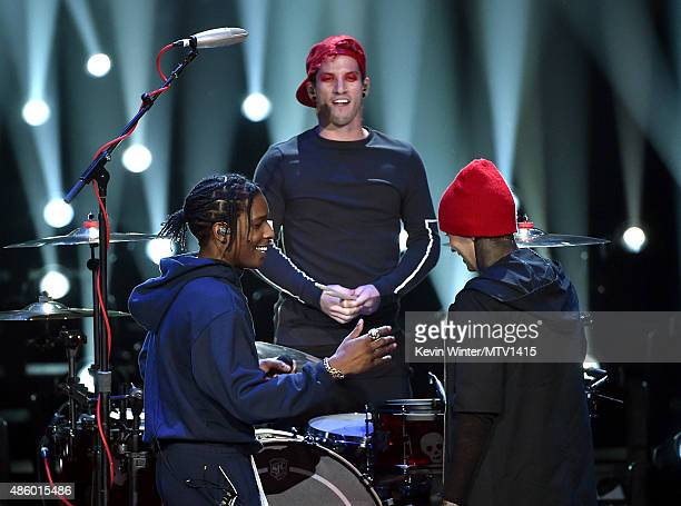 Recording artists A$AP Rocky and Josh Dun and Tyler Joseph of Twenty One Pilots perform onstage during the 2015 MTV Video Music Awards at Microsoft...